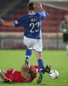 Diamond's captain Chris Hope slides in on Halifax's Nicky Gray