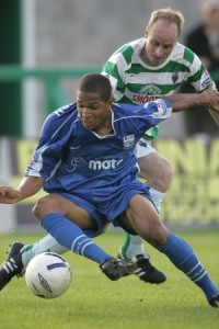 Simeon Jackson turns away from this challenge